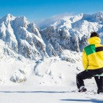 Guy With Snow Pants And Ski Jacket Watching the landscape in front of him