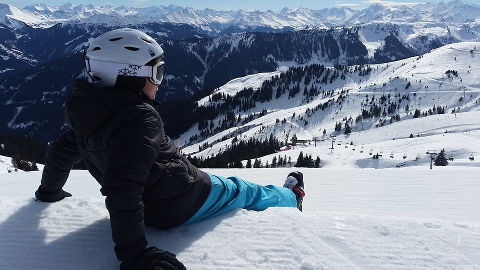 Person Sitting On Snow
