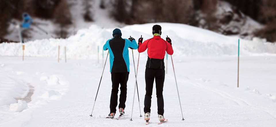 two people skiing
