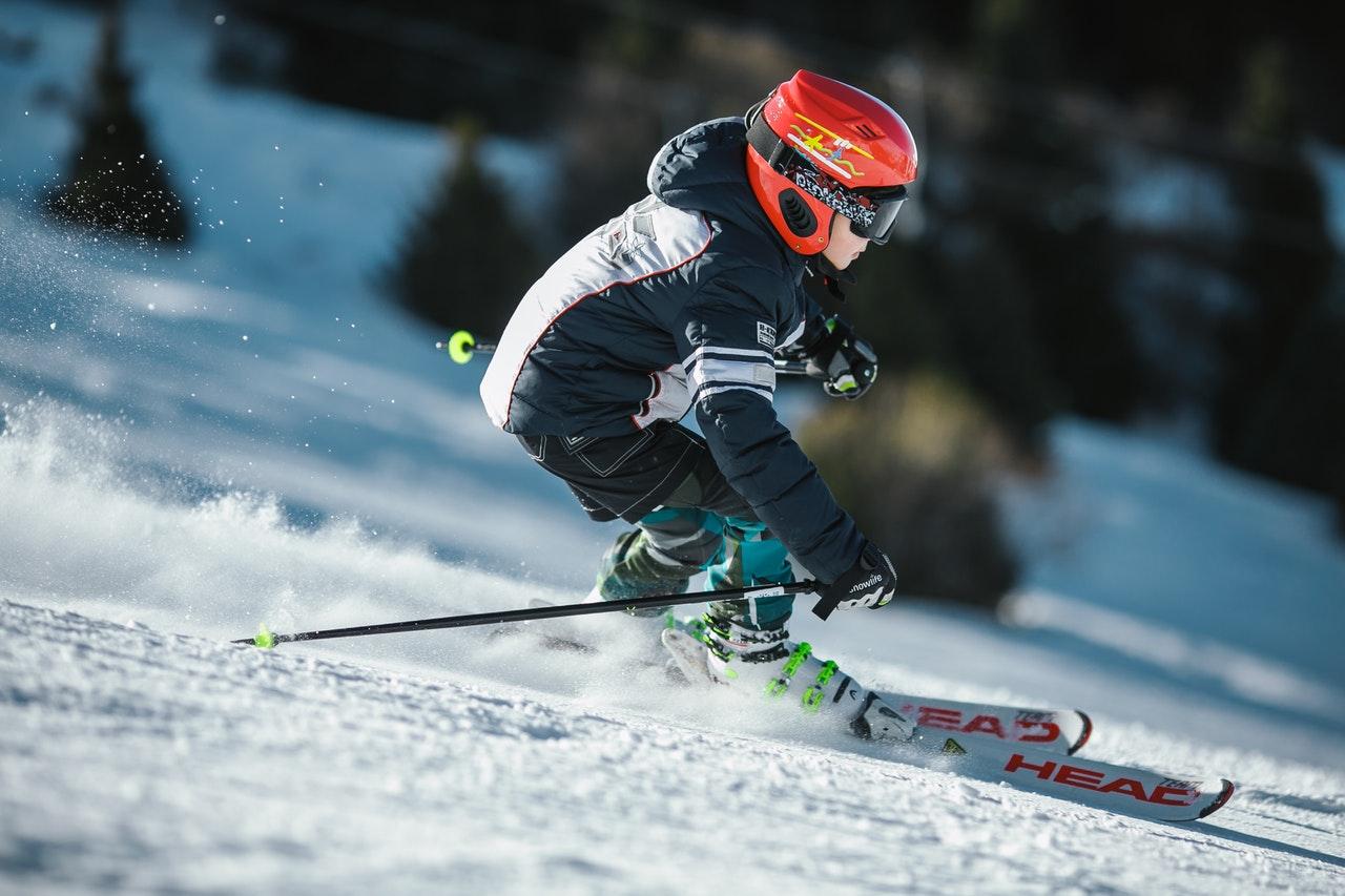 Man ice skiing on snow field