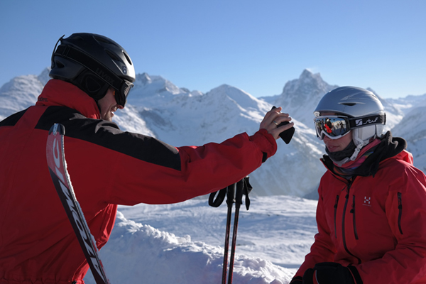 couple wearing red jacket for skiing